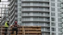 Construction workers chat on a condominium building site in Toronto, Oct. 3, 2016. (© Chris Helgren / Reuters)