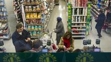 Customers shop at the Dollarama discount store location at Spadina Ave and Adelaide St. West in Toronto (Kevin Van Paassen/The Globe and Mail)