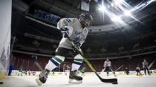 A minor hockey player takes part in First Strides, put on by the Canucks in Vancouver on December 5, 2011. Separating concussions from other conditions [post-traumatic stress disorder, headaches, anxiety] has not always been easy or accurate. Even among athletes in contact sports such as hockey and football, brain autopsies have found wildly different circumstances. (JOHN LEHMANN/The Globe and Mail)