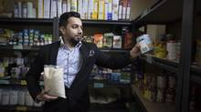 Najam Syed, head of the food bank at the Mississauga Muslim Community Centre, shelves items at the centre on Monday. Food banks are having difficulty adjusting to changing demographics and sourcing culturally appropriate foods. (Fred Lum/The Globe and Mail)