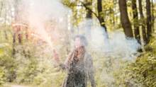 Woman playing with firework in the forest. (Mosuno/Handout)