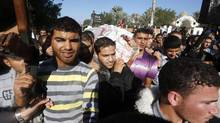 Palestinians carry the body of Ahmed Jaabari, Hamas's military chief, during his funeral in Gaza City, Nov. 15, 2012. (Mohammed Salem/REUTERS)