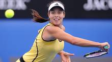 Serbia's Ana Ivanovic returns the ball to Shenay Perry of the United States during their Women's first round singles match at the Australian Open tennis championship in Melbourne, Australia Tuesday, Jan. 19, 2010. (Andrew Brownbill/AP)
