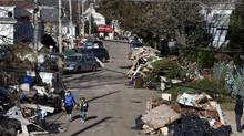 Garbage lies piled on the street in the New Dorp neighbourhood of Staten Island, N.Y., in the aftermath of Superstorm Sandy. (Seth Wenig/AP)