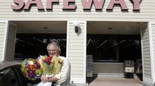 A customer buys flowers at a Safeway store in Mountain View, Calif., in this file photo. (Paul Sakuma/AP)