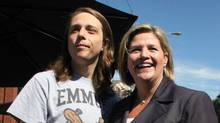 NDP leader Andrea Horwath and her son Julian Leonetti at the Locke Street festival in Hamilton, Sept. 10 (Anna Mehler Paperny/The Globe and Mail)