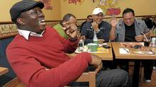 Comedian Russell Peters (white ball cap) gathers with fellow comedians (from left): Arthur Simeon, Jean Paul and Ron Josol. (Fred Lum/The Globe and Mail)