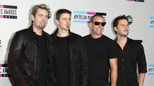 Rock band Nickelback poses on arrival at the 2011 American Music Awards in Los Angeles November 20, 2011. (DANNY MOLOSHOK/DANNY MOLOSHOK / REUTERS)