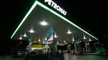 Motorists pump petrol at a Petronas station in Putrajaya in this December 8, 2009 file photograph. (Reuters)