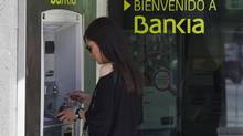 A woman uses a Bankia bank automated teller machine (ATM) in Madrid. (SERGIO PEREZ/REUTERS)