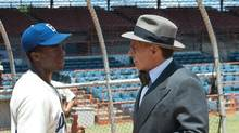 Chadwick Boseman and Harrison Ford in 42, the story of Jackie Robinson.