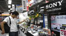 A shopper takes a look at Sony's digital camera at an electronics retail store in Tokyo, Japan, Thursday, July 28, 2011. (Shizuo Kambayashi/AP Photo/Shizuo Kambayashi/AP Photo)