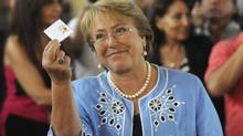 Chilean president-elect Michelle Bachelet shows her vote in Santiago during the election on Dec. 15. Her her coalition won 55 per cent of the senate vote and 57 per cent of the lower house. (STRINGER/REUTERS)