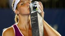 Karolina Pliskova of the Czech Republic kisses her trophy after winning her final match against Bethanie Mattek-Sands of the United States at the WTA Malaysian Open tennis tournament in Kuala Lumpur, Malaysia, Sunday, March 3, 2013. (Lai Seng Sin/AP)