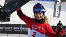Canada's Dominique Maltais celebrates her second place finish following the women's World Cup snowboarder cross event in Lake Louise, Alta., Saturday, Dec. 21, 2013. (Jeff McIntosh/THE CANADIAN PRESS)