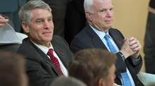 United States Senators Mark Udall, left, and John McCain attend the opening of the Halifax International Security Forum in Halifax on Friday, Nov. 16, 2012. Delegates will be discussing pressing security issues, including the impact of the American presidential election, the turmoil in Syria, cybersecurity and modern warfare. (Andrew Vaughan/THE CANADIAN PRESS)