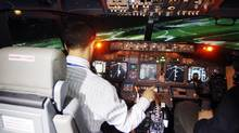 CAE Inc. flight test pilot, Captain Louardi Necib flies simulator 737 destined for Malaysia, in Montreal, Quebec, April 21, 2010. (Christinne Muschi For The Globe and Mail)