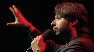 Jian Ghomeshi speaks to a Los Angeles crowd before a live broadcast of his radio show 'Q' at The Broad Stage in Santa Monica, Oct. 16 2014.