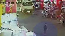 In this image taken from Oct. 13, 2011, security camera video run by China's TVS, a two-year-old girl, identified as Wang Yue, is seen just before she is hit by a white van, seen in background, in China's southern Guangdong province. The video showing a toddler being struck twice by vans and then ignored by passers-by is sparking outrage in China and prompting soul-searching over why people didn't help the child. (AP)