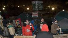 Demonstrators form a wooden barricade around a fountain at the Occupy protest site as the midnight deadline to take down the camp has passed in Ottawa early Tuesday morning November 22 2011. (Fred Chartrand/The Canadian Press/Fred Chartrand/The Canadian Press)