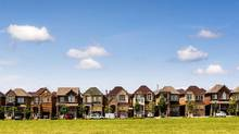 Houses are seen in Vaughan, Ont., north of Toronto, in this June 29, 2015, file photo. If houses in the Greater Toronto Area were affordable for middle-class families, they'd cost an average $228,657. The actual average in September was $627,395. (MARK BLINCH/REUTERS)