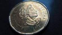 A Canadian dollar or loonie (Jonathan Hayward/THE CANADIAN PRESS)
