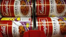 Cans of vegetable Campbell's condensed soup are stocked on a shelf at a grocery store in Phoenix, Arizona, February 22, 2010. (JOSHUA LOTT/REUTERS)