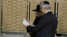 """Canada's Prime Minister StephenHarper looks at a Bible with Western Wall Rabbi Shmuel Rabinowitz as they stand in front of the Western Wall, Judaism's holiest prayer site, during his visit to Jerusalem's Old City January 21, 2014.Harpertold Israel's parliament on Monday any comparison between the Jewish state and apartheid South Africa was """"sickening"""", drawing a standing ovation - and an angry walkout by two Arab legislators. (Ammar Awad/REUTERS)"""