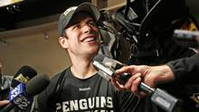 Pittsburgh Penguins' Sidney Crosby talks with reporters at his locker after skating at the Penguins' practice facility in Cranberry Township, Pa., Tuesday, Oct. 11, 2016. Crosby was diagnosed with a concussion by team doctors Monday. (Gene J. Puskar/AP)