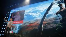 Ubisoft Montreal executive producer Dan Hay introduces Far Cry 4 to the audience at E3 on Monday. Gamers have complained of a dearth of software for the new generation of consoles. (LUCY NICHOLSON/REUTERS)