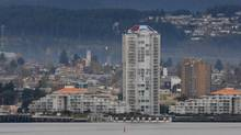 A passenger float plane takes off from the harbour over the skyline in downtown Nanaimo, B.C. (Don Denton/The Canadian Press)