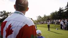 Fans watch Canada's Mike Weir tee off on the fourth hole during the 2008 Canadian Open at Glen Abbey Golf Club (Mike Cassese/Reuters)