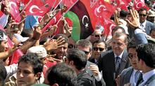 Turkey's Prime Minister, Tayyip Erdogan, greets people upon his arrival at a rally in Tripoli on Sept. 16, 2011. (SUHAIB SALEM/REUTERS/SUHAIB SALEM/REUTERS)