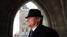Conservative MP Gerard Deltell pose for a photograph on the front steps of Parliament Hill February 24, 2016 in Ottawa. (Dave Chan)