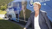 Parti Quebecois Leader Pauline Marois walks from her campaign bus during a campaign stop in Murdochville Que., on Tuesday, August 7, 2012. (Jacques Boissinot/THE CANADIAN PRESS)