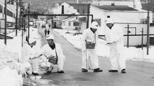 Photo dated Dec. 18, 1952. Original Caption: Tracking down Radiation -- A team of white-clad specialists from the Royal Canadian Engineers are shown here on the job at Chalk River helping to locate excessive radiation which escaped from the reactor at Canada's big Atomic Energy Plant. Left to Right are Sgt. G.E. Green, Regina; Spr. D.A. Miller, Cornwall, Ont.; Spr. T.B. Gorman, Halifax and Cpl. F.D. MacKenzie, Kentville, N.S. (The Canadian Press from National Defence/The Canadian Press from National Defence)