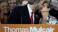 Thomas Mulcair kisses his wife, Catherine Pinhas, after capturing the NDP leadership at the Metro Toronto Convention Centre in Toronto, March 24, 2012 (Kevin Van Paassen/The Globe and Mail)