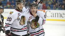 Portland Winterhawks left winger Taylor Leier, left, congratulates centre Chase De Leo on his goal against the London Knights during the third period of Memorial Cup action in Saskatoon, Sask. on Monday, May 20, 2013. (Liam Richards/THE CANADIAN PRESS)