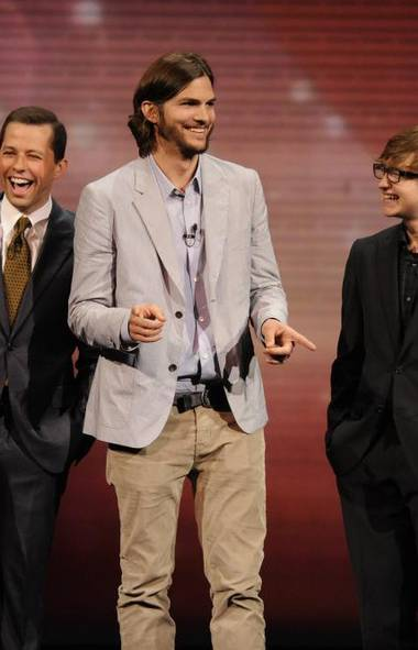 """Ashton Kutcher, the 35-year-old actor who replaced Charlie Sheen after his ouster from the hit TV show in 2011, topped the list for the second consecutive year with $24-million. """"TV's highest-paid actor is laughing all the way to the bank since replacing Sheen on 'Two and a Half Men' after the troubled star's 2011 flameout,"""" said Forbes, adding that Kutcher is also an investor in technology companies. (JEFFREY R. STABB/CBS)"""