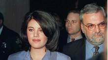 Monica Lewinsky and her then attorney William Ginsburg, right, leave a Washington restaurant in 1998. (The Associated Press)