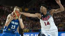 United States's Anthony Davis, right, duels for the ball beside Finland's Antero Lehto, during the Group C Basketball World Cup match between United States and Finland (ALVARO BARRIENTOS/AP)