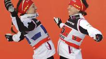 Perianne Jones (right) of Almonte, Ont. and Dara Gaiazova of Banff, Alberta do a chest bump before accepting the bronze medal in team sprint competition at a FIS cross country World Cup and Sochi Olympics test event in Sochi, Russia, Sunday, Feb. 3, 2013. (Mike Ridewood/THE CANADIAN PRESS)