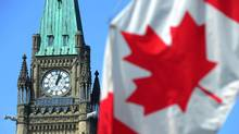 A Canadian flag flies on Parliament Hill in Ottawa. (Sean Kilpatrick/THE CANADIAN PRESS)