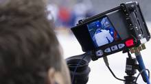 An HBO 24/7 crew members film the Toronto Maple Leafs including Leafs Head Coach Randy Carlyle during practice at the Air Canada Centre in Toronto on December 04, 2013. (Deborah Baic/The Globe and Mail) (Deborah Baic/The Globe and Mail)