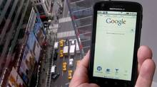 A posed picture shows a Motorola Droid phone displaying the Google search page in New York Aug.15, 2011. (Brendan McDermid/Reuters/Brendan McDermid/Reuters)