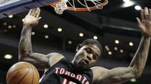Toronto Raptors' Amir Johnson (15) beats Detroit Pistons' Tayshuan Prince to the basket for a dunk in the first half of an NBA basketball game Monday, April 12, 2010, in Auburn Hills, Mich. (AP Photo/Duane Burleson) (Duane Burleson)