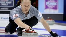 Skip Brad Jacobs throws a rock against Team Stoughton at the Roar of the Rings Canadian Olympic Curling Trials in Winnipeg, Manitoba December 1, 2013. (STRINGER/REUTERS)