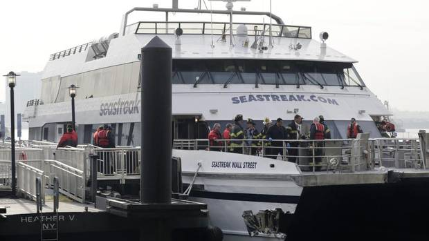 The Seastreak Wall Street ferry is shown in New York on Jan. 9, 2013. The ferry from New Jersey made a hard landing at the dock as it pulled up to lower Manhattan during Wednesday morning rush hour, injuring at least 57 people, two critically, officials said. (Mark Lennihan/AP)