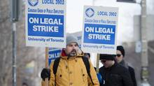 Striking members of CUPE 3902, including University of Toronto teaching assistants, lab assistants, and graduate student instructors, picket on the U of T campus on Monday, March 2, 2015. (Darren Calabrese for The Globe and Mail)