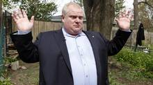Toronto Mayor Rob Ford talks to reporters on the land at the public park behind his house where he confronted Toronto Star reporter Daniel Dale because, Mr. Ford claims, was taking photos over his wooden fence, Toronto May 03, 2012. (Fernando Morales/The Globe and Mail)